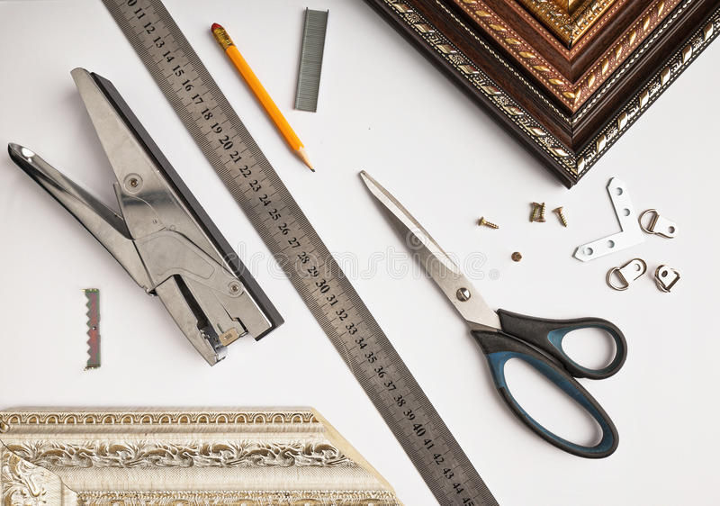 Accessories for picture framing studio on a white background stock images