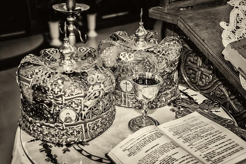Accessories of a priest for a church wedding with crowns.  stock photography