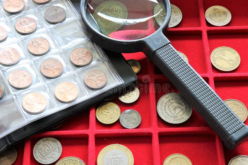 Numismatic job. World coins collection, investment. Accessories are visible in the background stock photography