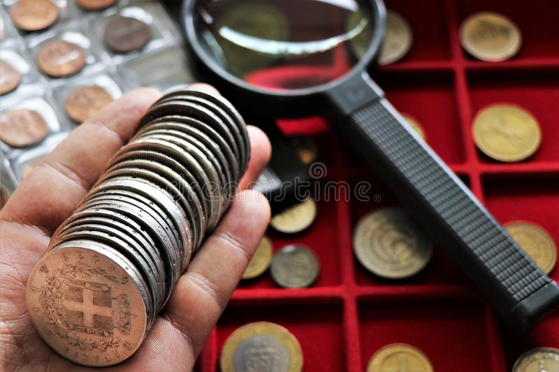 Numismatic job. World coins collection, investment. Accessories are visible in the background royalty free stock photography