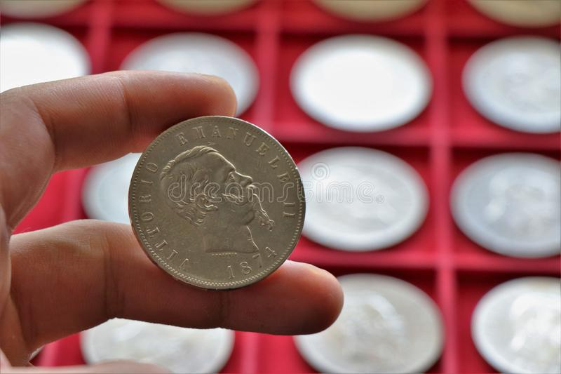 Numismatic job. World coins collection, investment. Accessories are visible in the background stock photos