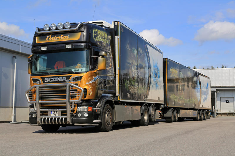 Accessorized Scania V8 Trailer Truck Transports Frozen Food. FORSSA, FINLAND - AUGUST 23, 2014: Accessorized Scania V8 trailer truck transports frozen food to a royalty free stock photo