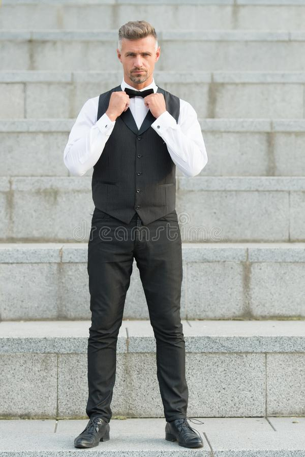 Accessory matters. Gentleman modern style. Guy well groomed handsome bearded gentleman macho adjusting bow tie stock photography