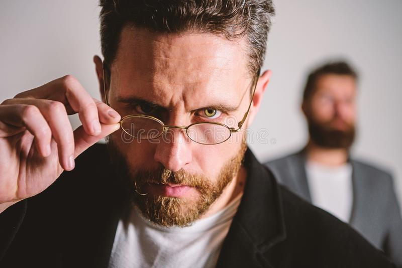 Accessory for smart appearance. Now i see everything. Attentive glance. Picky smart inspector. Man handsome bearded guy. Wear eyeglasses. Eye health and sight royalty free stock photography