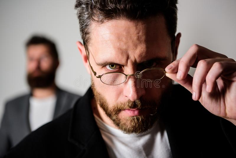 Accessory for smart appearance. Now i see everything. Attentive glance. Picky smart inspector. Man handsome bearded guy. Wear eyeglasses. Eye health and sight royalty free stock photo