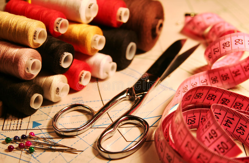 Accessory of the tailor. Scissors, stitching, measuring tape