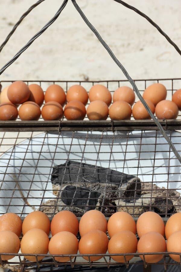Acción asada a la parrilla de la foto del huevo foto de archivo libre de regalías