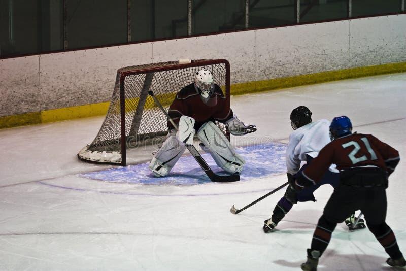 Acción del hockey sobre hielo foto de archivo
