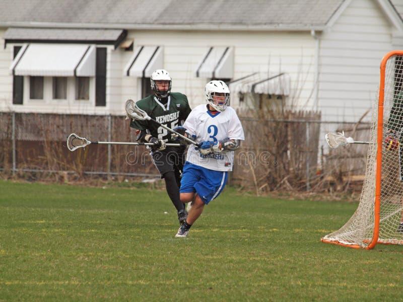 Acción del lacrosse foto de archivo