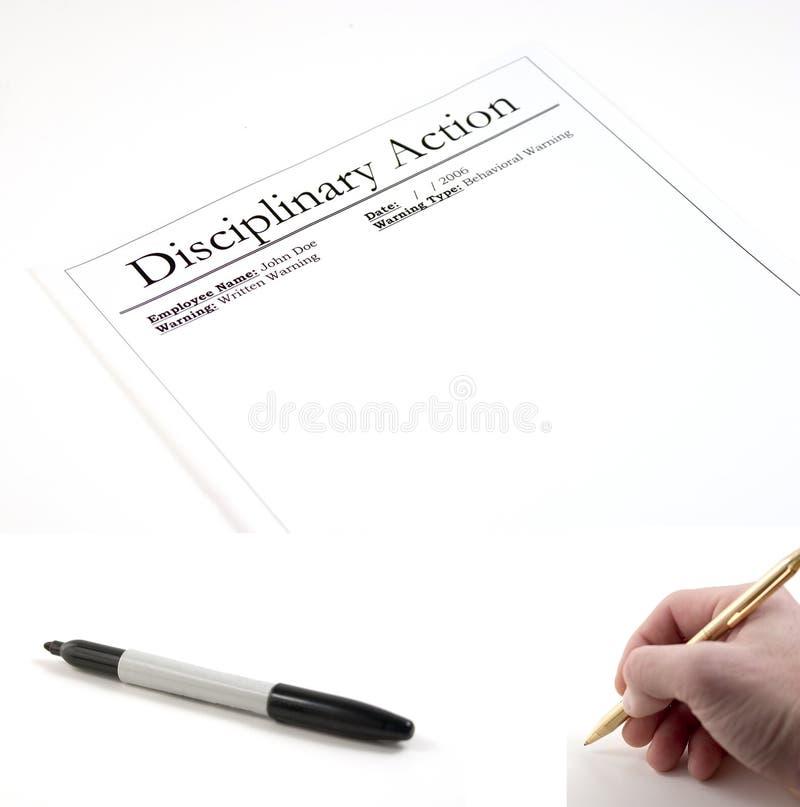 Acción disciplinaria (etiqueta de plástico y mano con la pluma incluida para ser PA imagenes de archivo