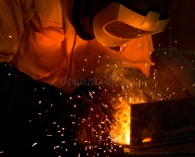 Acciaio e scintille industriali della saldatura fotografia stock