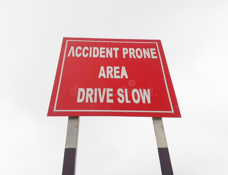 Drive slow, accident prone area sign board on the highway, roadside. Accident, accident prone, alert, area, areas, background, banner, beware, board, caution stock photography