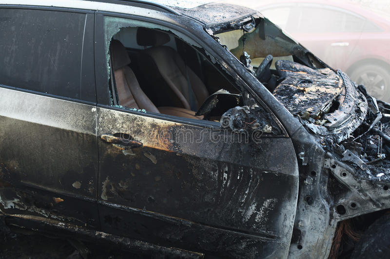 Accident or arson burnt car on the road. Closeup royalty free stock images