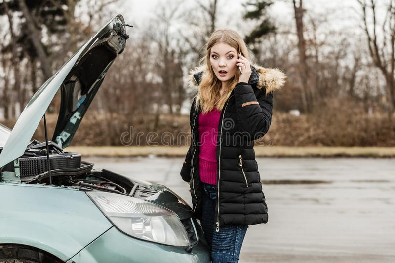 Broken down car, woman calling to somebody royalty free stock photo
