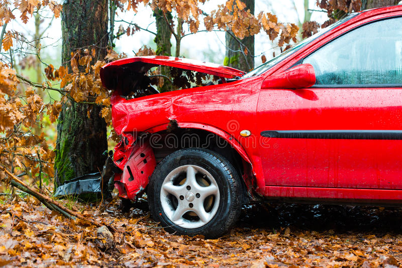 Accident - car crashed into tree stock images
