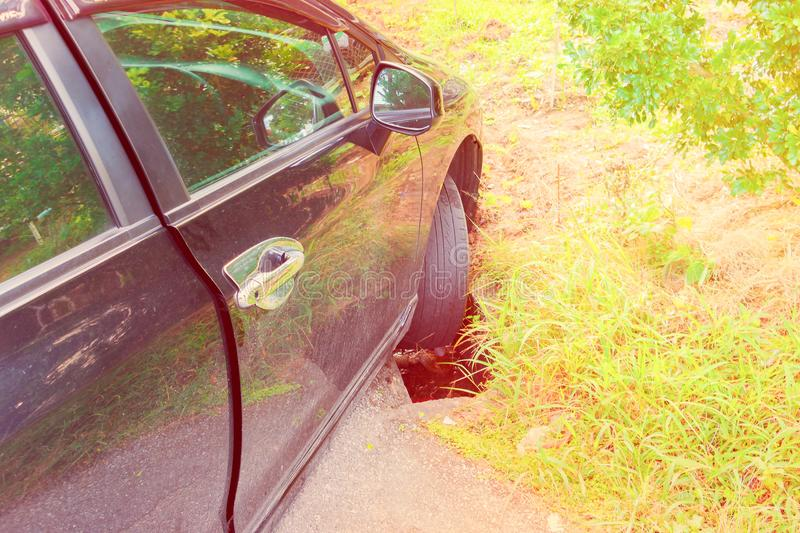 Accident car fall ditch on the road.  stock image