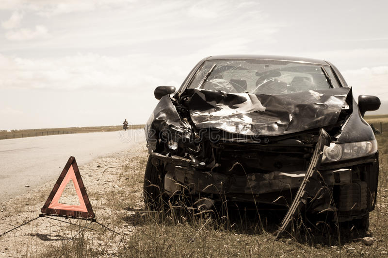 Accident car and warning triangle. Beside road royalty free stock images