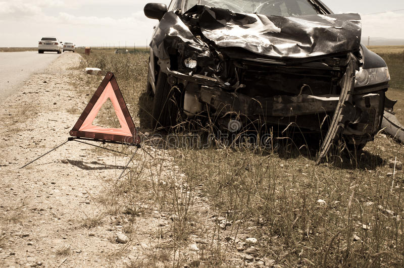 Accident car and warning triangle. Beside road royalty free stock image