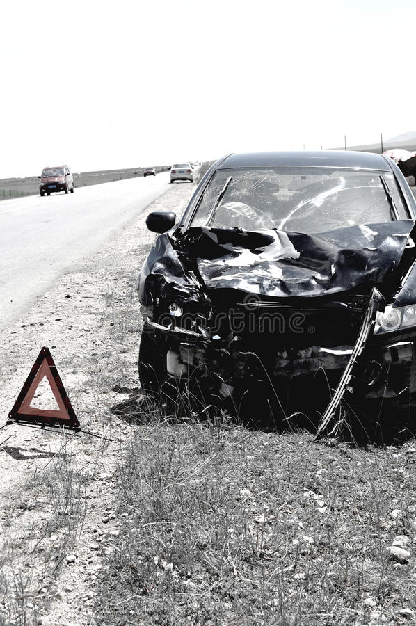 Accident car and warning triangle. Beside road stock photography
