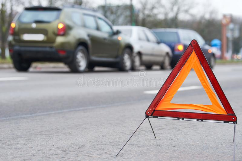 Accident or crash with two automobile. Road warning triangle sign in focus. Car crash in city street. Accident with two automobile. Road warning triangle sign in stock photo