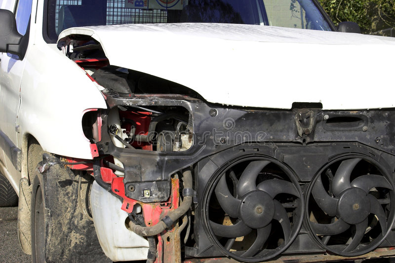 Accident Damaged Vehicle. An accident damaged vehicle with front end damage royalty free stock photos