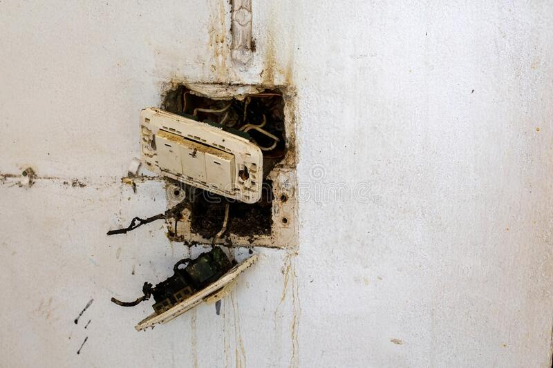 The accident from electric plug is burn and spark off block plastic on the wall stock photos