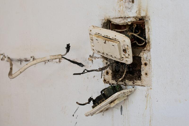 The accident from electric plug is burn and spark off block plastic on the wall royalty free stock photography