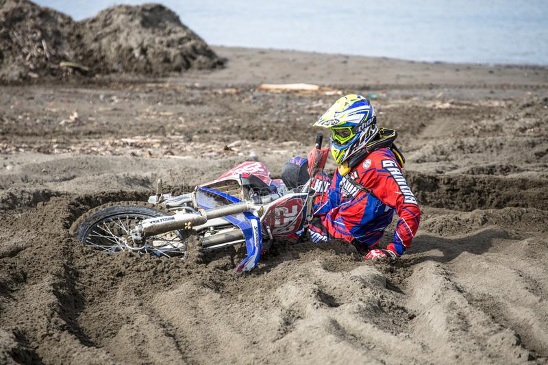 Accident on motocross race on the beach in Genoa, Italy royalty free stock image