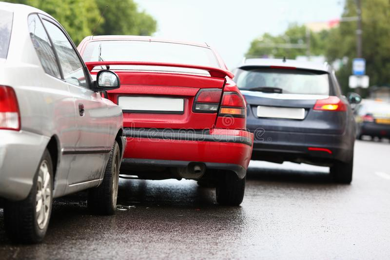 Accident of red and silver car after rain royalty free stock photo