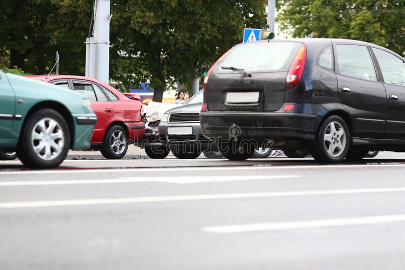 Accident of red and silver car after rain stock photo