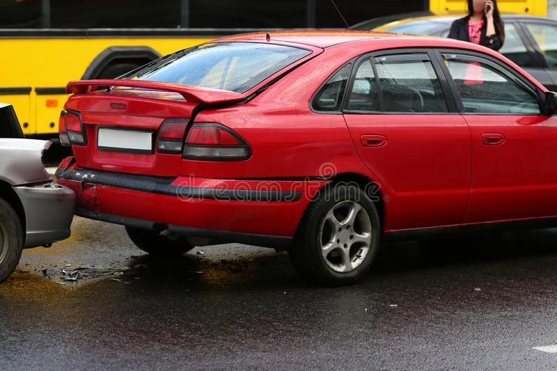 Accident of red and silver car after rain stock photography