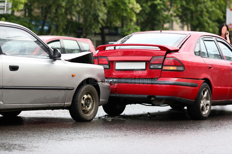 Accident of red and silver car after rain stock photos