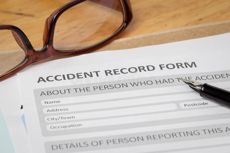 Accident report application form and pen on brown envelope and e. Yeglass, business insurance and risk concept; document is mock-up royalty free stock photography