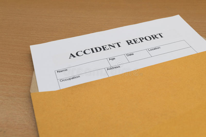 Accident report form. On brown envelope stock photo