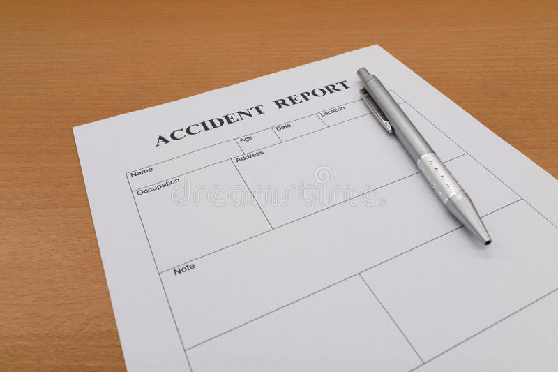 Accident report form with pen on table royalty free stock photography