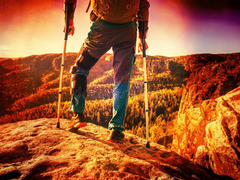 Accident tourist man walk by crutches on path while travel stock image