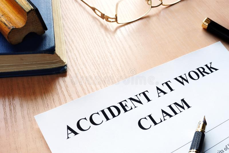 Accident at work claim form on a table. royalty free stock images
