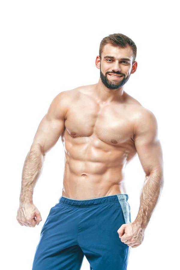 Accidente plano Poder deportivo hermoso del varón del individuo Aptitud muscled en pantalones cortos azules En fondo blanco aisla fotografía de archivo