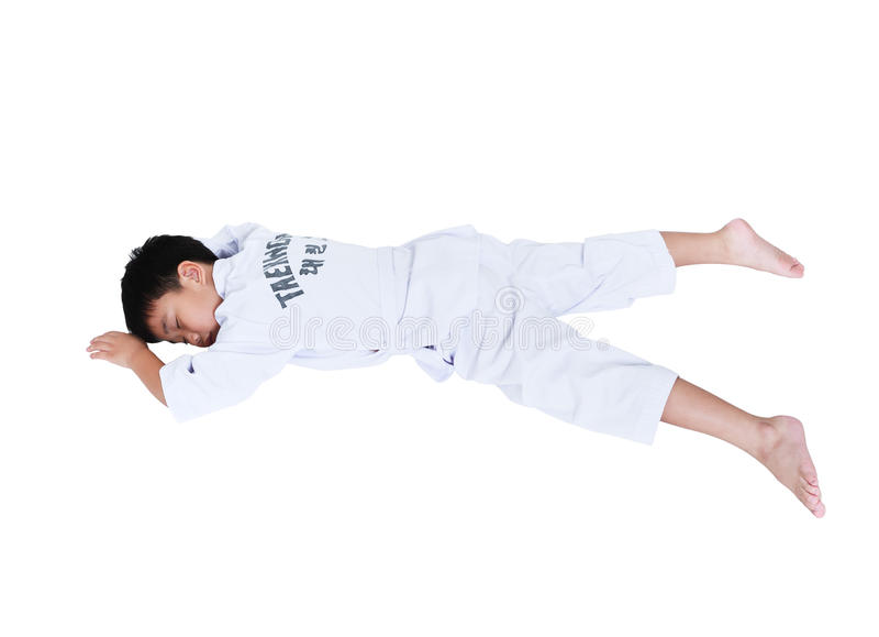 Accidents in sports. Asian child athletes taekwondo lying prone royalty free stock images