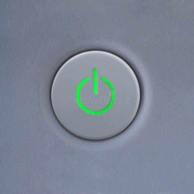 Accione el botón en el ordenador. foto de archivo libre de regalías