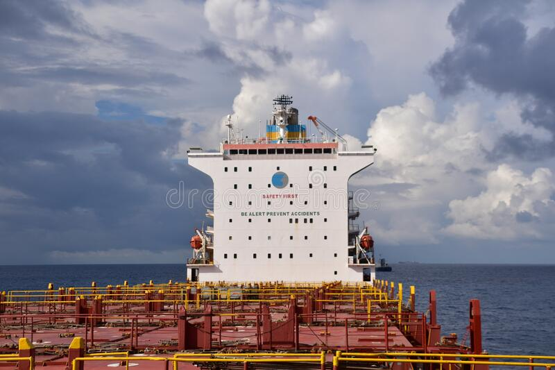 Accommodation of a big container vessel and empty hatch covers stock image