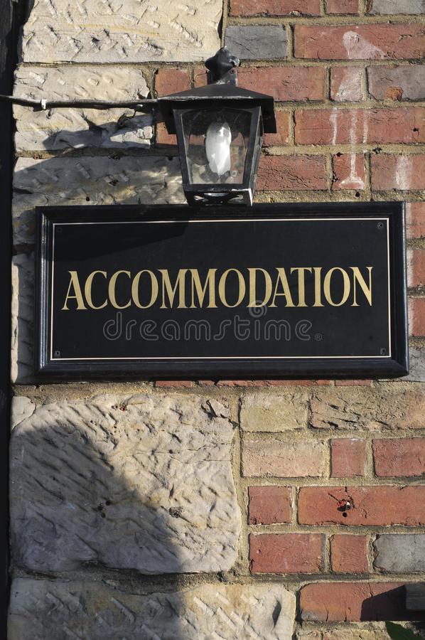 Accomodation sign. On brick wall stock images