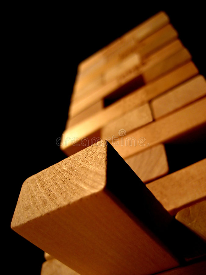 Accomplishment!. A tower of wooden blocks. Great for portraying the idea of accomplishment and team building royalty free stock images