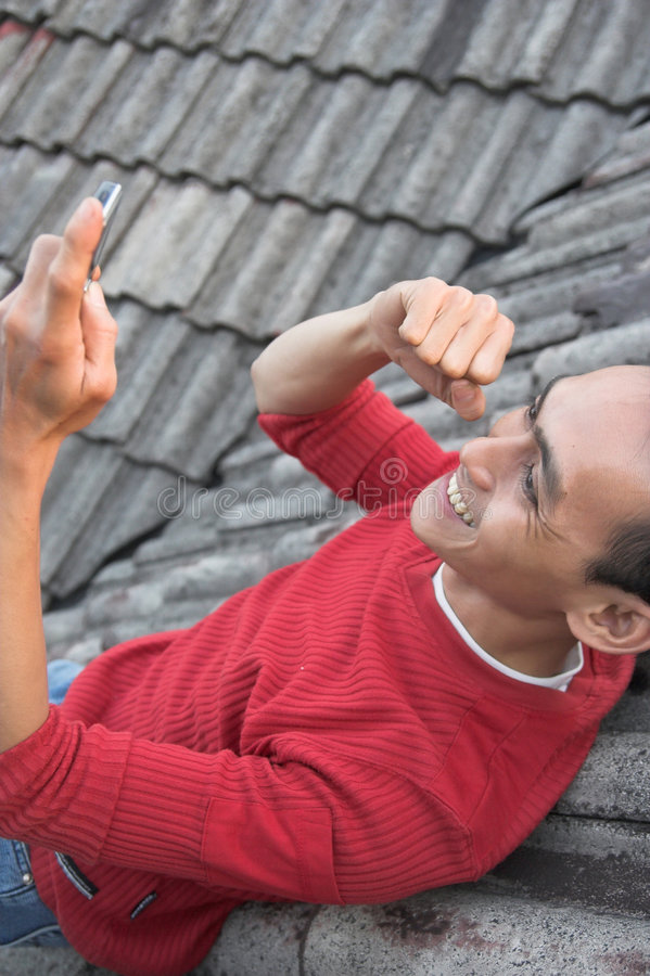 Accomplissement de téléphone portable photos stock