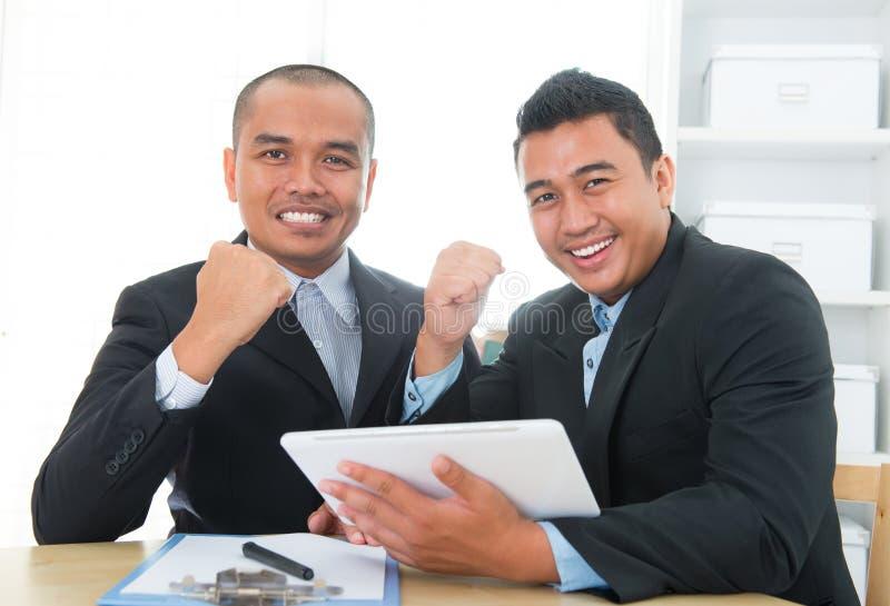Accomplissement du sud-est de businessteam images libres de droits