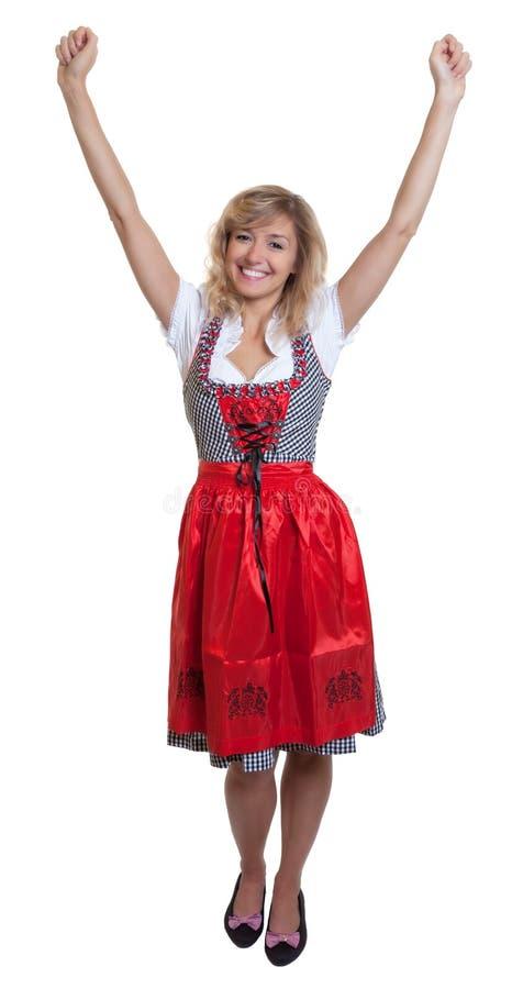 Accomplissez le corps d'une femme allemande dans un dirndl bavarois traditionnel image libre de droits
