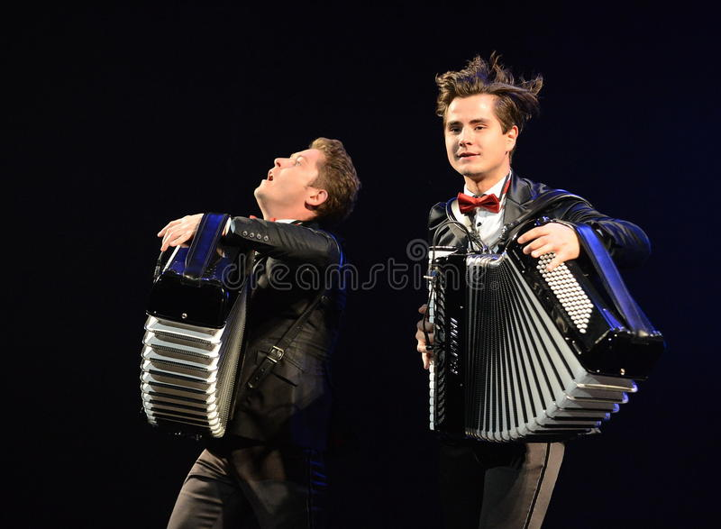 The accordion-brothers Kirill and Konstantin Bondarenko. MOSCOW, RUSSIA -JUNE 28, 2014:The accordion-brothers Kirill and Konstantin Bondarenko royalty free stock photos