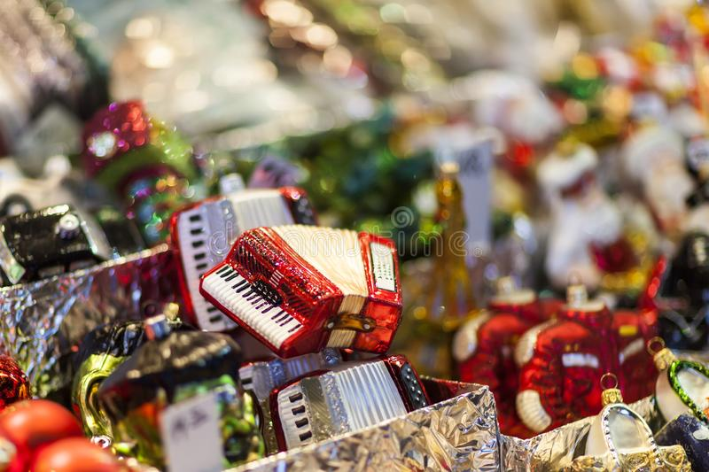 Accordion christmas ornament on the advent market stall, close up. Photo stock image