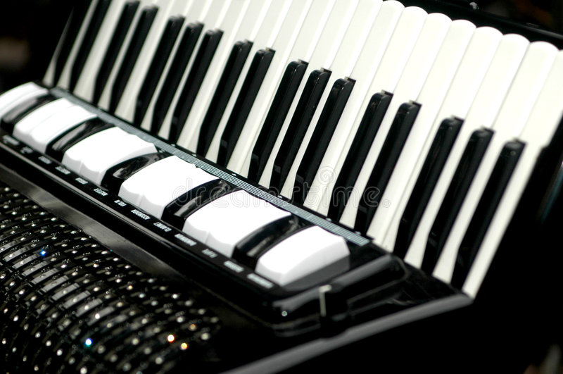Accordion, musical instrument. Musical intrument called the accordion. A portable wind instrument with a small keyboard and free metal reeds that sound when air stock images