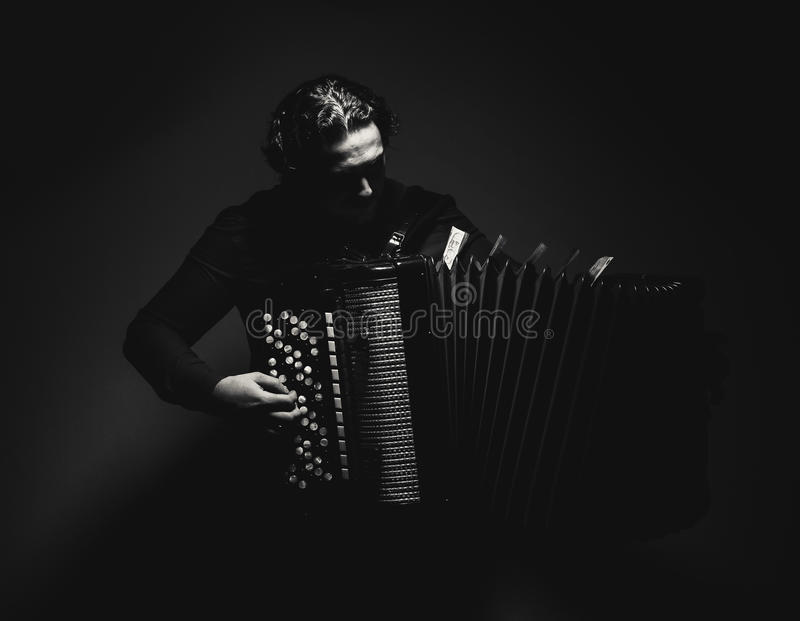 Accordion Player in Black and White. Modern accordion player with Serbian money on an instrument, in black and white royalty free stock photos